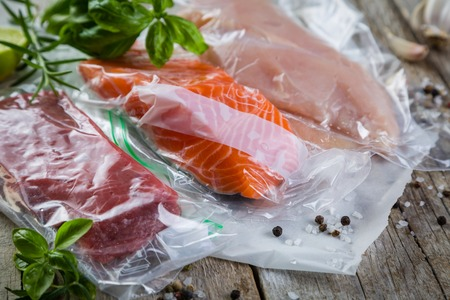 Beef, chicken and salmon in vacuum plastic bag for sous vide cooking Stock Photo