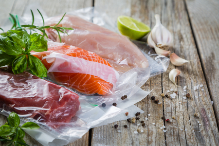Beef, chicken and salmon in vacuum plastic bag for sous vide cooking Stock Photo - 74051041