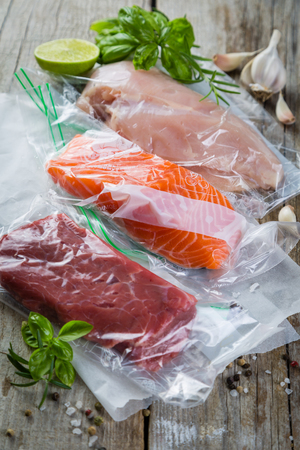 Beef, chicken and salmon in vacuum plastic bag for sous vide cooking Stockfoto