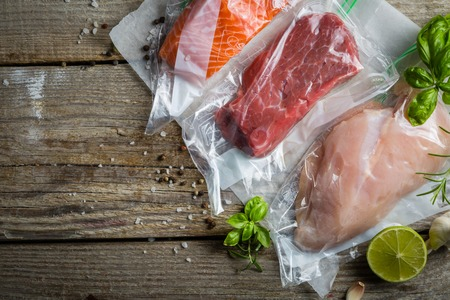 Beef, chicken and salmon in vacuum plastic bag for sous vide cooking 版權商用圖片