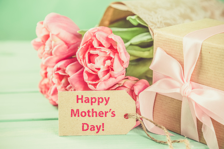 Mothers day card with coffee, present, flowers