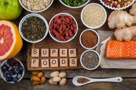 Selection of superfoods on rustic background, copy space Stock Photo