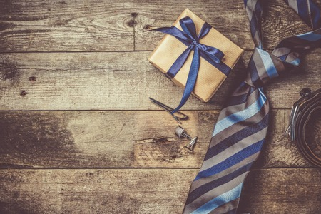 Fathers day concept - present, tie on rustic wood background Banco de Imagens
