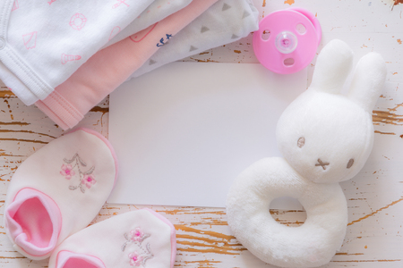 Baby shower concept - child essencials on wood background