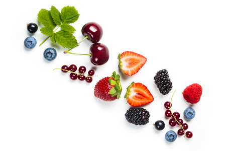Fresh berries on white background, top view