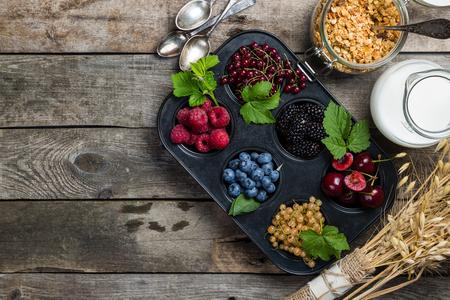Breakfast concept - granola, milk and berries