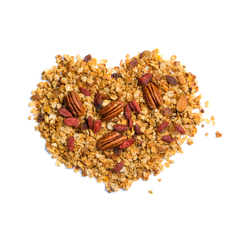 Healthy diet concept - heart shaped granola with nuts Banco de Imagens