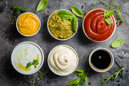 Selection of different sauces in bowls