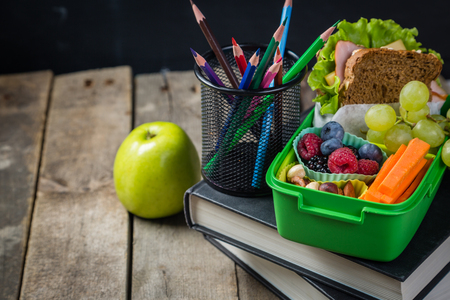 Back to school concept - healthy lunch and stationary,