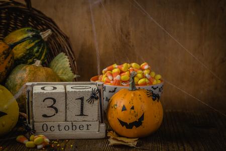 Halloween concept - pumpkins and calendar block Stock Photo