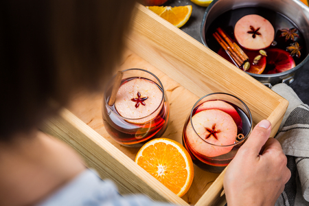 Holding mulled wine in glasses Stock Photo - 87209238