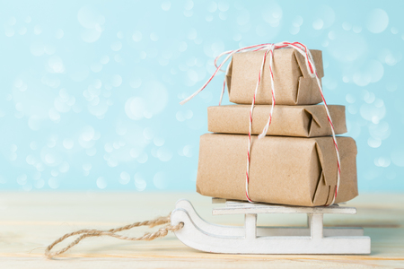 Christmas delivery concept - stack of presents, on santa sled