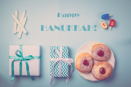 Symbols of hanukkah on blue background Stock Photo