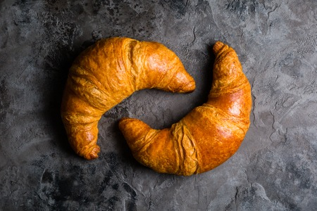 Croissants on rustic background
