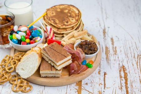 Selection of food that can cause diabetes, healthcare concept Stockfoto