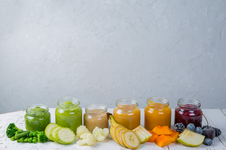 Colorful baby food purees in glass jars Stock Photo