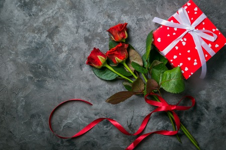 Valentines day concept - presents, flowers and glasses