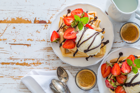 Waffles with strawberry, ice cream and chocolate