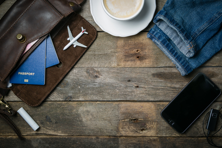 Traveling concept - essentials, camera, phone and plane model Stock Photo
