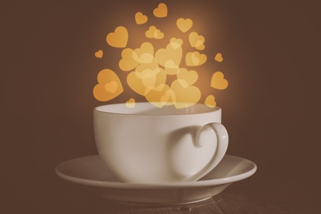 Valentines day concept - cup with heart shaped bokeh background
