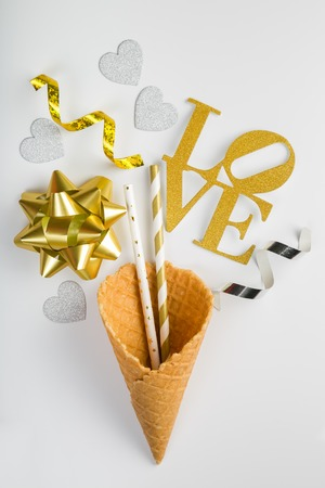 Valentines day concept - ice cream cone and party decorations