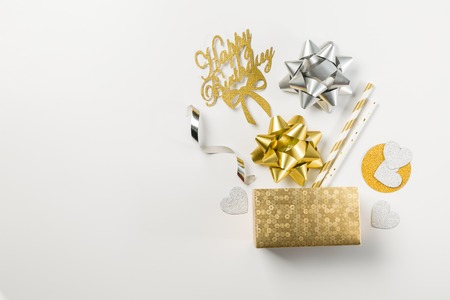 Birthday concept - golden box abd decorations on white background