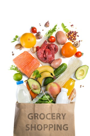 Grocery shopping concept. Balanced diet concept. Fresh foods with shopping bag on white background