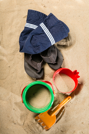 Summer concept - sand and toys, shoes