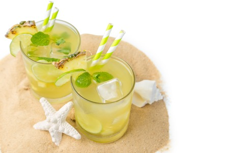 Pineapple and lime drink on rustic background Stock Photo