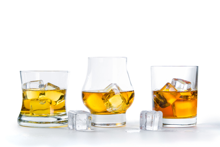 Strong alcohol drinks - whiskey, bourbon, scotch on white background