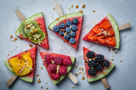 Watermelon pizza - slices with berries and fruits, granola. Fresh low carb diet 写真素材 - 96076090