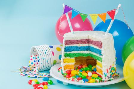Rainbow pinata cake with candies - birthday background, card, concept Banco de Imagens