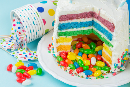 Rainbow pinata cake with candies - birthday background, card, concept Stock Photo