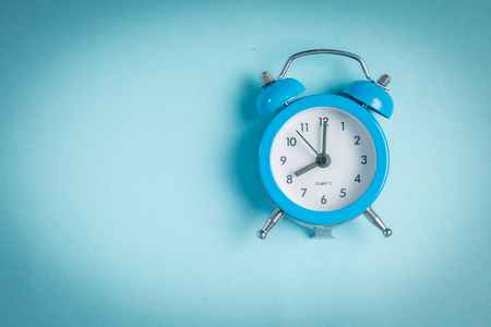 Morning concept - vintage clock on blue background Stock Photo