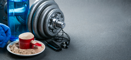 Sport concept - gym supplies on yoga mat background Stock Photo