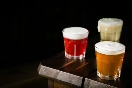 Taiwanese food trend - cheese tea assortment on rustic wood background