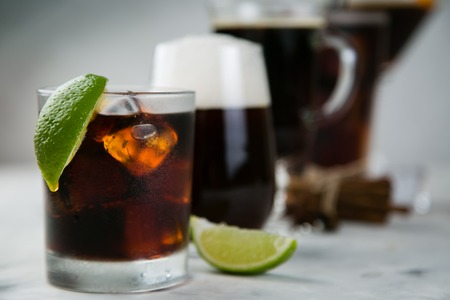 Selection of black cocktails in different glasses, marble background Stock Photo