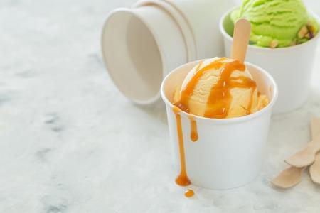 Caramel ice cream in paper cone Stock fotó