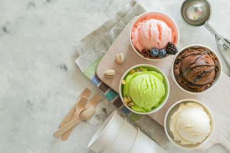 Selection of colorful ice cream scoops in paper cones 스톡 콘텐츠