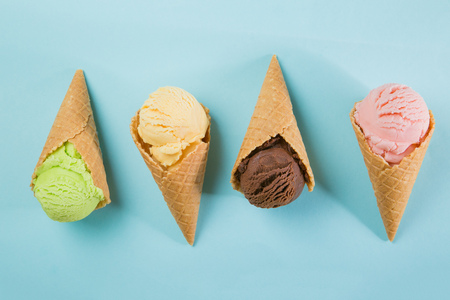 Selection of colorful ice cream scoops on blue background
