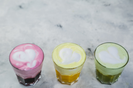 Selection of colorful super lattes on marble background