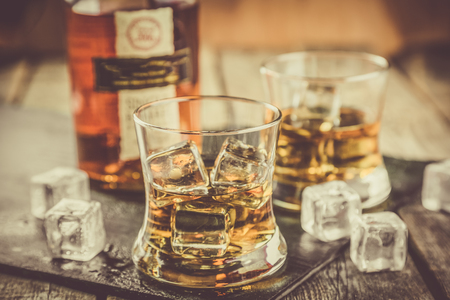 Bourbon on rustic wood background Stock Photo