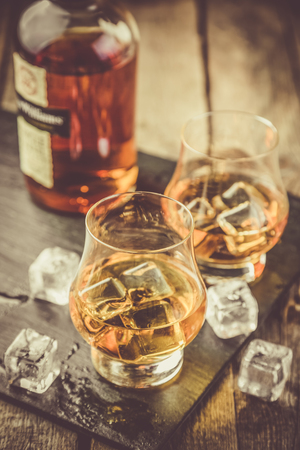Whiskey on rustic wood background