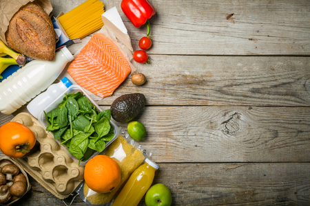 Grocery shopping concept. Balanced diet concept. Fresh foods with shopping bag on rustic wood background, top view, copy space, flat lay Archivio Fotografico