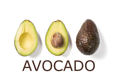 Slices of avocado on white background. Whole and half with leaves. Design element for product label. Top view Stock Photo