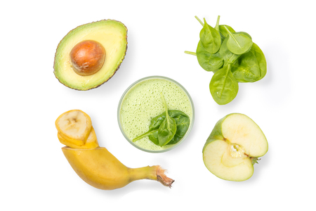 Healthy lifestyle concept - green smoothie and ingredients, isolated on white, top view Stock Photo