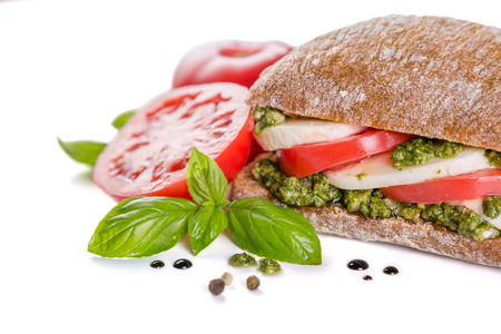 Intalian cuisine concept - caprese salad sandwich with ciabatta, isolated on white Stock Photo