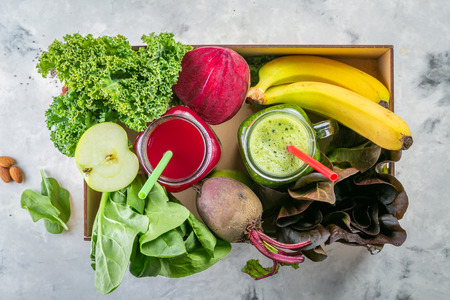 Alkaline diet concept - green and purple smoothies and ingredients Stock Photo