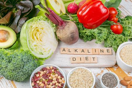Alkaline diet concept - fresh foods on rustic background