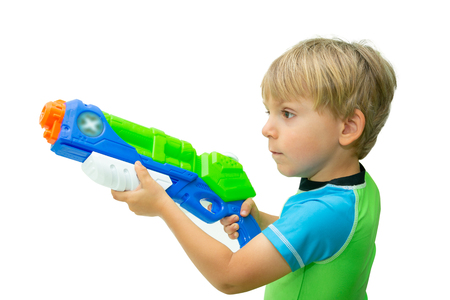 Boy holds water gun isolated on white Stock Photo